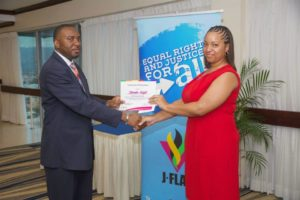 Jamaica's Chief medical offi cer Dr. Kevin Harvey with graduate of JFlag's public health workers training