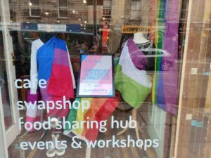 Mannequins wearing Pride flags in a shop window
